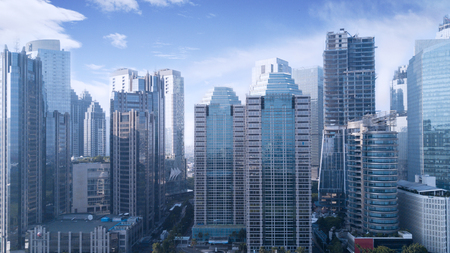 Beautiful aerial view of office buildings under blue sky in Jakarta, Indonesia