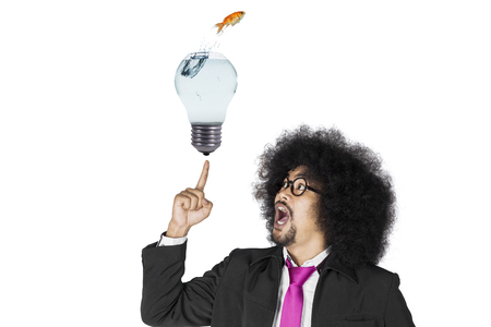 Creativity concept: Businessman with his aha moment isolated over white