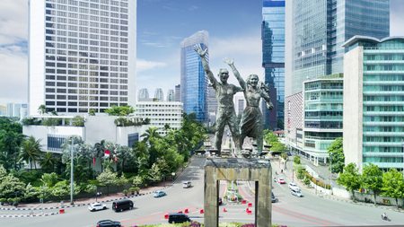 Beautiful aerial view of Welcome Statue with office building in Jakarta downtown  Publikacyjne