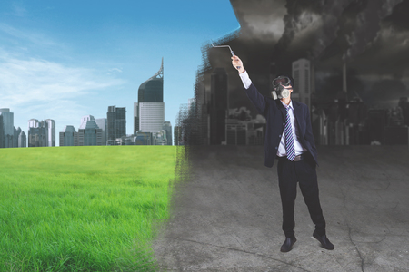 Go Green concept: Businessman with mask creating a better working environment picture