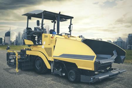Asphalt spreader or asphalt pavers machine parking on road construction site Stock Photo