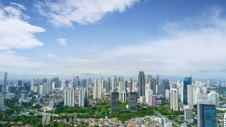 Aerial view of skyscrapers under blue sky in Jakarta. Indonesia