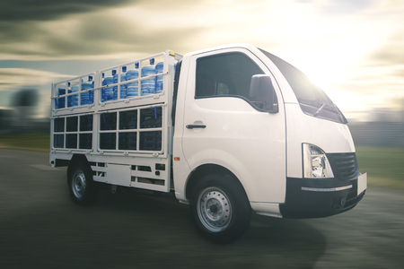 Light commercial truck delivering water gallon parked on the road Stock Photo