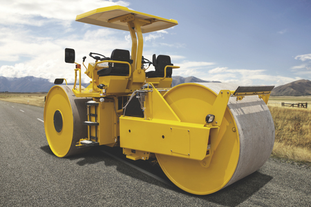 Yellow steamroll parked on a highway construction site