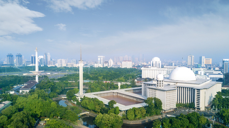 Beautiful aerial view of Istiqlal mosque with skyscraper in the downtown at Jakarta, Indonesia