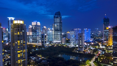 JAKARTA, Indonesia. Jan 24, 2018: Aerial night view of Jakarta cityscapes near Kuningan Central Business District. Shot from a drone at blue hour after sunset Stock fotó - 96737739