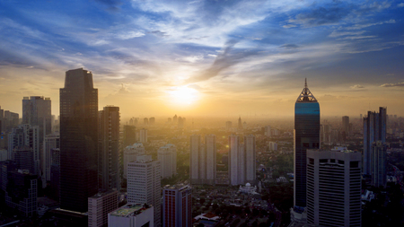 Aerial view of Jakarta Central Business District shot from a drone at sunrise Stock Photo