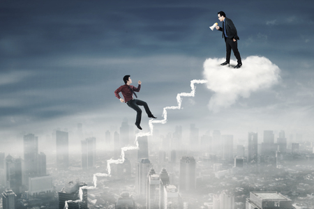 Portrait of male worker running on the stair to meet his leader on the cloud