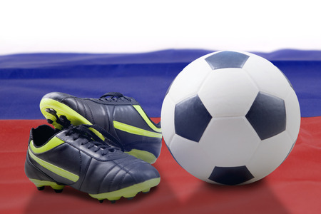 Photo of soccer boot and soccer ball over Russia flag isolated over white