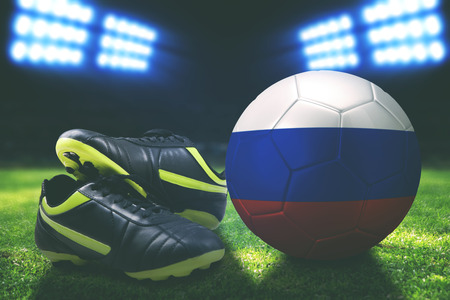 Photo of soccer boot with Russia soccer ball in stadium Stock Photo
