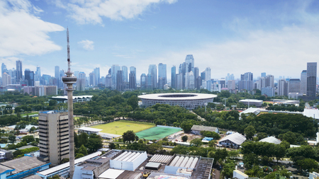 JAKARTA - Indonesia. March 12, 2018: Indonesia TV station building and Senayan stadium complex with Jakarta cityscape in the background Редакционное