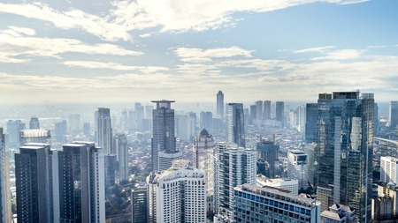 JAKARTA - Indonesia. March 12, 2018: Jakarta skyline with modern office and apartment buildings at sunny day