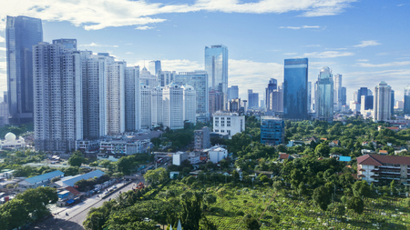 JAKARTA - Indonesia. March 12, 2018: Apartment and office buildings at Jakarta Central Business District with city park near Sudirman Road