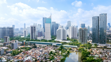 JAKARTA - Indonesia. March 12, 2018: Panoramic view of Jakarta cityscape with residential houses, modern office and apartment buildings at sunny day Stok Fotoğraf