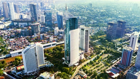 JAKARTA - Indonesia. March 12, 2018: Aerial photo of iconic BNI 46 Tower with surrounding buildings located in South Jakarta Central Business District, Standard-Bild