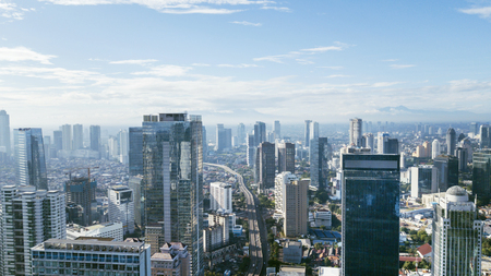 JAKARTA - Indonesia. March 12, 2018: Jakarta downtown cityscape with skyscrapers and apartment buildings at sunny day Standard-Bild