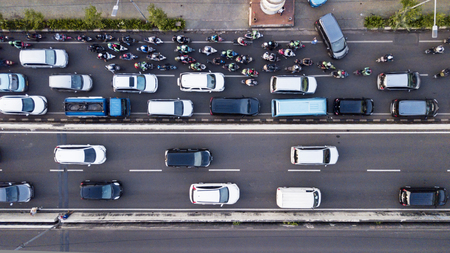 Aerial photo of Jakarta hectic traffic at peak hour with motorcycles and cars on the road