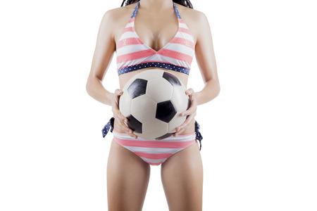 Picture of unknown woman holding a soccer ball, isolated on white background