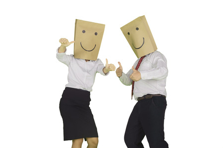 Two unknown business people showing thumbs up while standing in the studio, isolated on white background