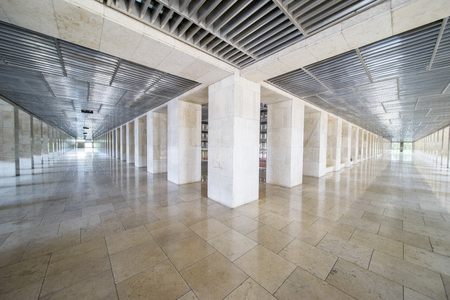 Beautiful view of long corridor with floor marble at the Istiqlal mosque in Jakarta, Indonesia