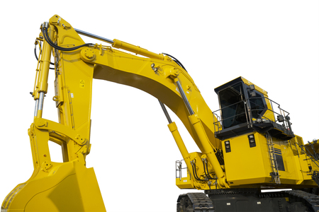 Closeup of a yellow excavator parked in the studio, isolated on white background