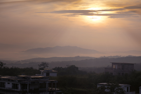 Beautiful landscape of sunrise on mountain valley in misty morning at Cikidang, Sukabumi, West Java, Indonesia