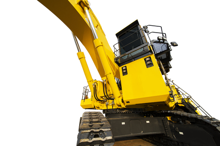 Low angle view of a heavy excavator with yellow color, isolated on white background Stock Photo