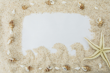 High angle view of an empty frame from white beach sand with starfish and seashells. Vacation concept Stock Photo