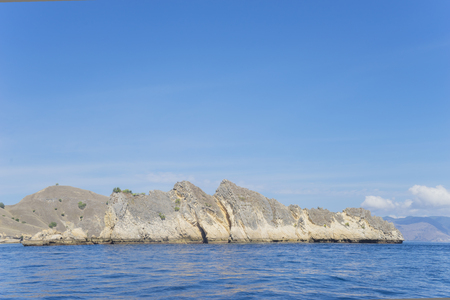 Beautiful scenery of huge cliff under blue sky in East Nusa Tenggara, Indonesia Stock Photo