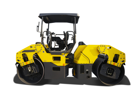Side view of modern road roller with yellow color, isolated on white background