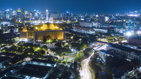 Aerial scenery of Jakarta downtown with glowing skyscrapers at night time