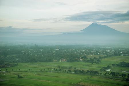 Beautiful landscape of mount Merapi near Prambanan temple at misty morning in Yogyakarta, Indonesia Stock Photo