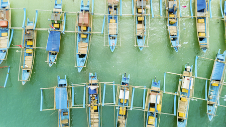 Top view of traditional fisherman boats in a row at the Ujung Genteng Beach, Sukabumi, West Java, Indonesia