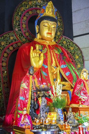 Image of Kwan Im statues inside a temple with decoration for Chinese New Year