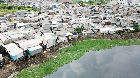 Aerial view of crowded slum houses on the lakeside at North Jakarta, Indonesia