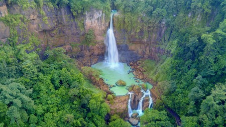 Aerial view of beautiful Cikaso waterfall in tropical forest at Sukabumi, West Java, Indonesia