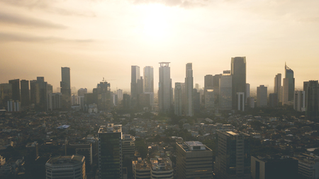 Image of beautiful modern downtown landscape at sunset time in Jakarta, Indonesia