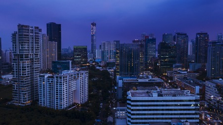 Aerial view of beautiful cityscape with skyscrapers at night in Jakarta, Indonesia