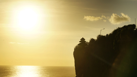 Image of Uluwatu temple on the high cliff at sunset time in Bali, Indonesia