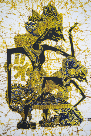 Image of beautiful batik painting with Wayang pattern on the fabric