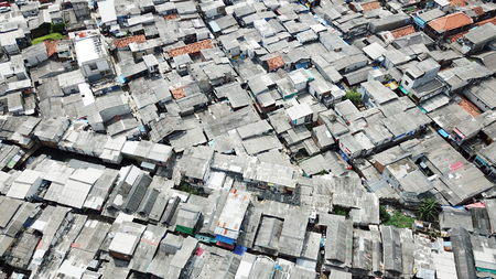 Aerial scenery of crowded houses in slum neighborhood area at North Jakarta, Indonesia