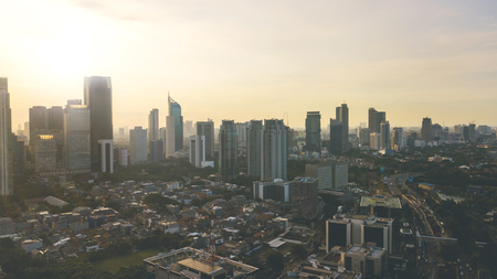 Aerial view of beautiful Jakarta city with skyscraper and residential house at sunset time