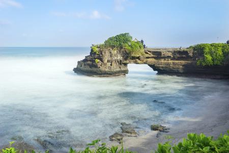 Beautiful scenery of Batu Bolong temple under blue sky in Bali, Indonesia Stock Photo