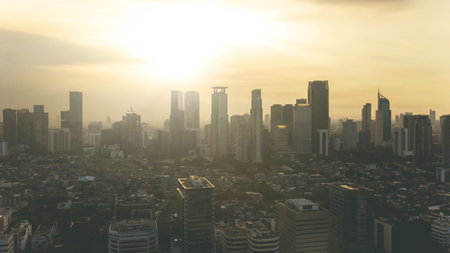Aerial view of sunset over office building in Central Business District of Jakarta, Indonesia Stock Photo