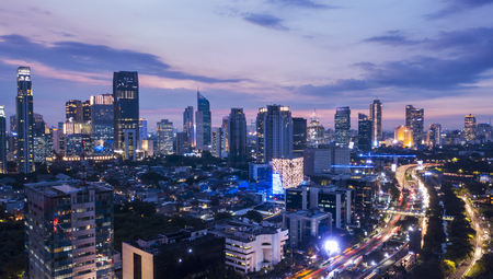 Beautiful aerial landscape of central business district of Jakarta from a drone at sunset time