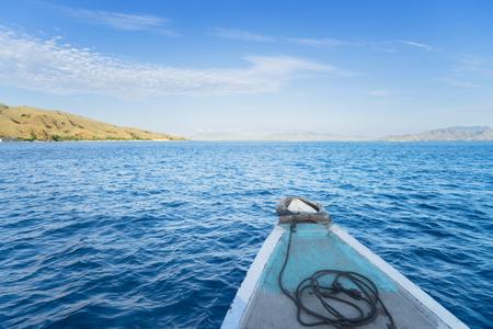 Beautiful tropical seascape from a wooden boat sailing towards Padar Island near Bali, Indonesia