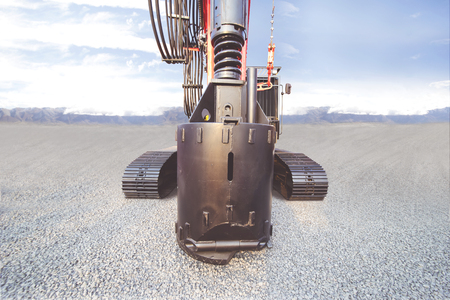 Closeup of big drill for drilling ground of a heavy duty machinery in the construction site Stock Photo