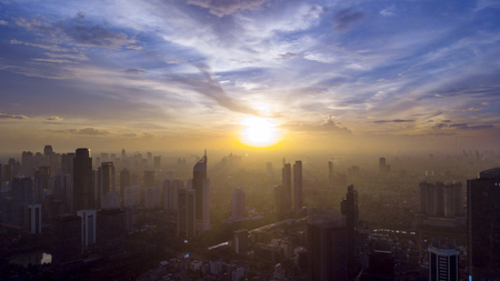 Top view of beautiful skyscrapers covered by mist at morning time in Jakarta, Indonesia