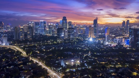 Beautiful landscape of downtown with skyscrapers at nightfall in Jakarta, Indonesia