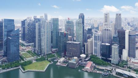 Beautiful aerial view of skyscrapers at waterfront. Shot at Marina Bay, Singapore 스톡 콘텐츠